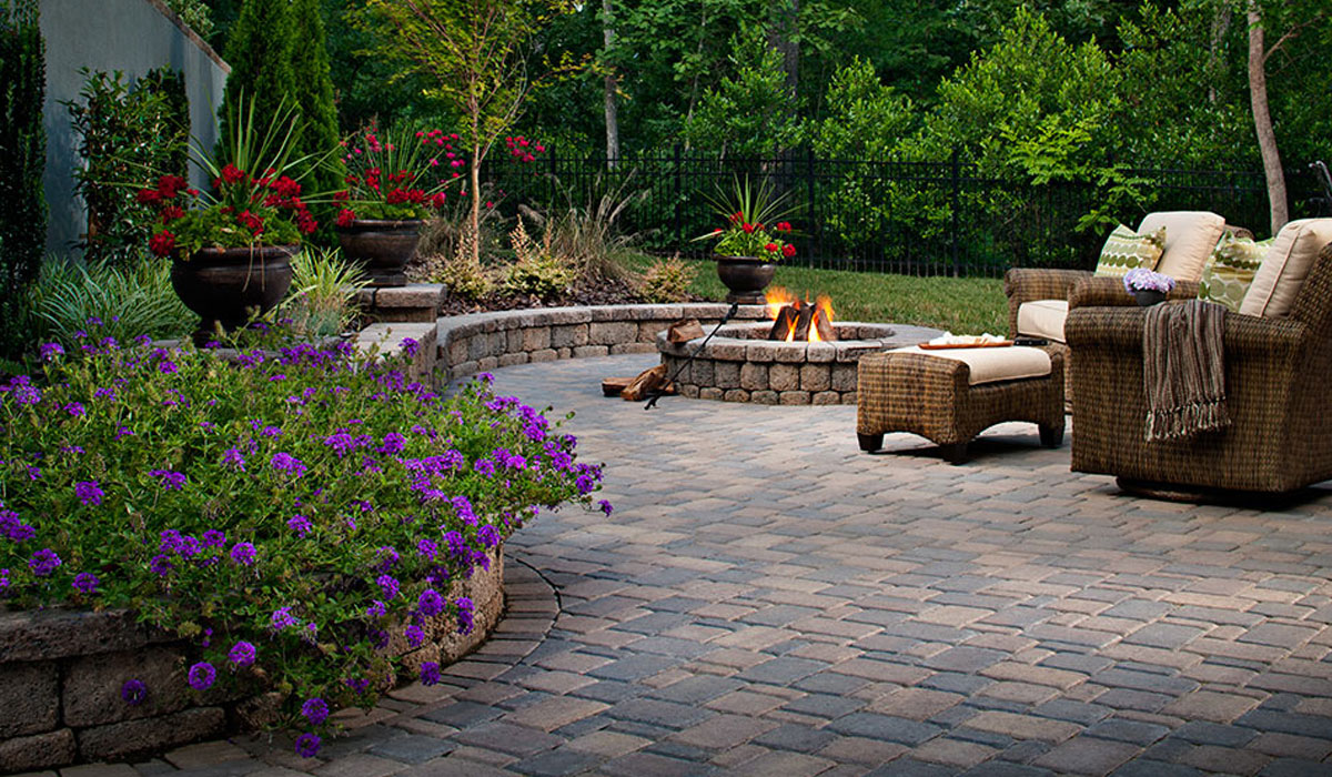 Outdoor retreat, Paver Patio, Stone Firepit and Wrap Around Planting Wall