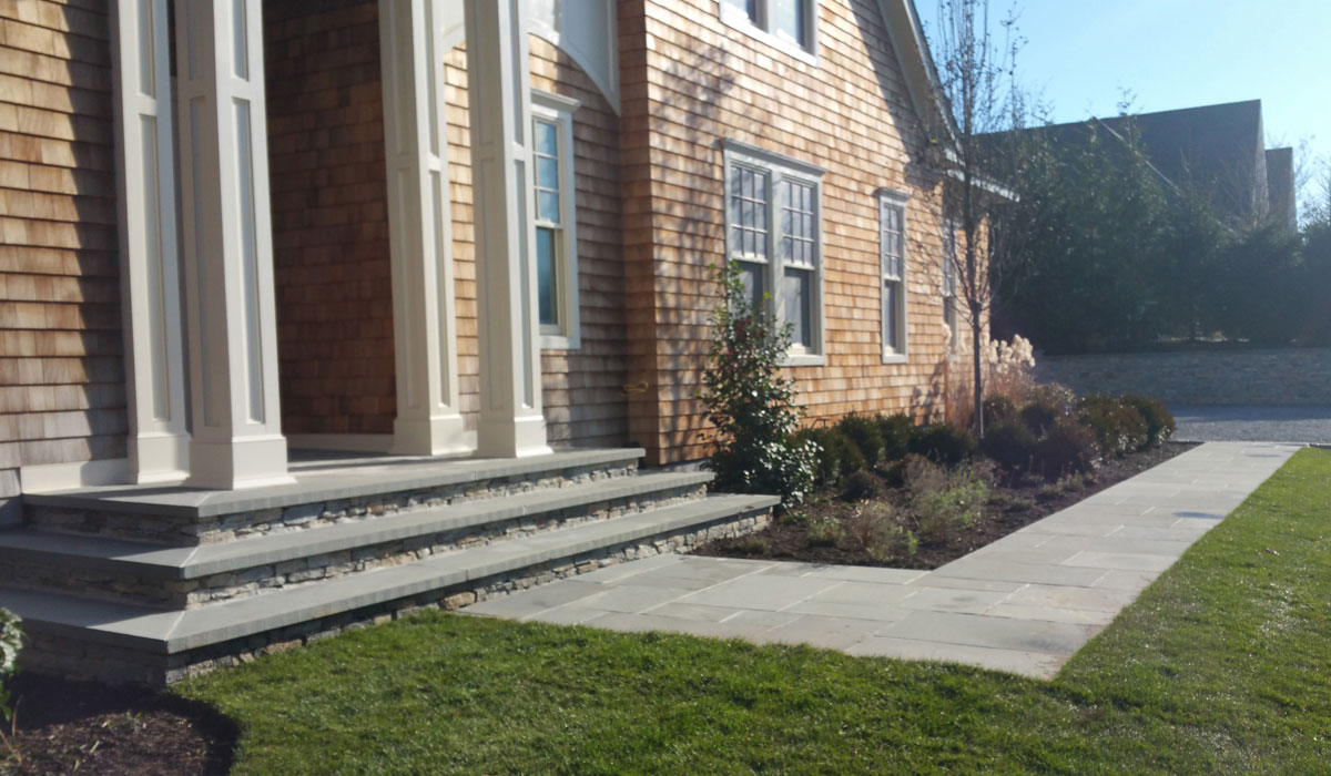 Southampton Masonry Design, Bluestone Home Entrance, Walkway, Stone Facing, Gravel Driveway and Stone Faced Retaining Wall