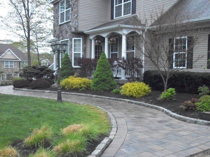 Hamptons East End Long Island Mason Design, Custom Walkway with Raised and Recessed Cobblestone Walkay Edging